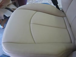 Auto upholstery repairs--don beautifully!